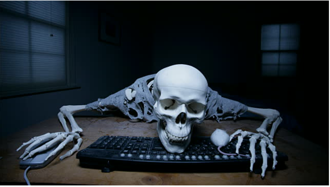 Skeleton over keyboard