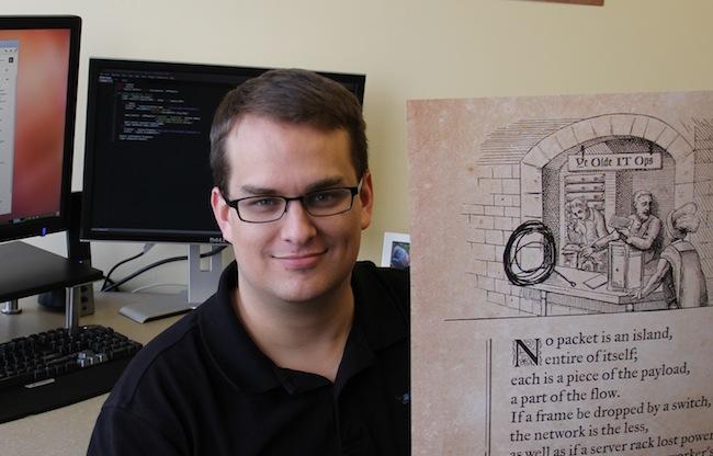 Ben holding poster